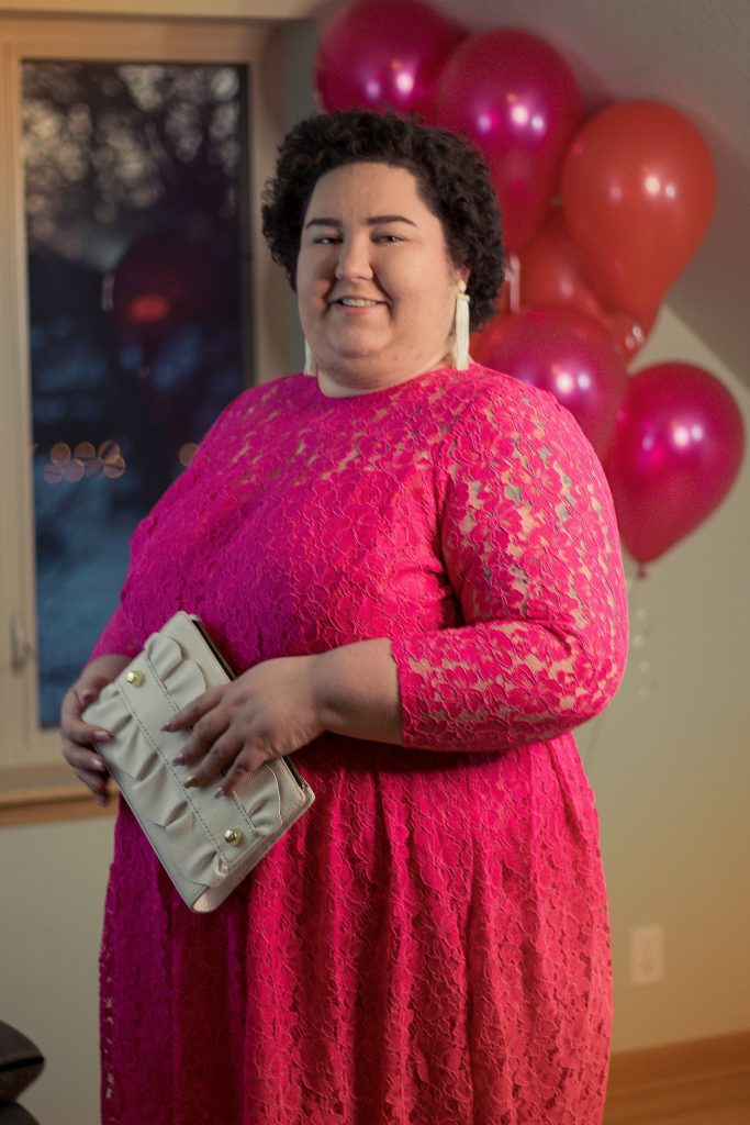 plus size woman in pink lace dress from eloquii