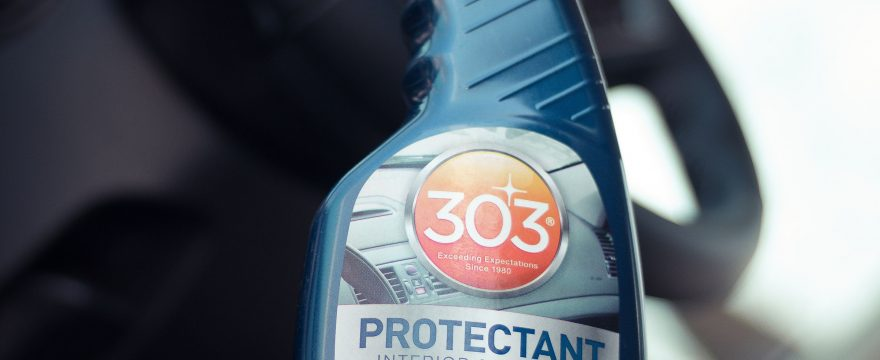 303 automotive detailing protectant with steering wheel in the background.