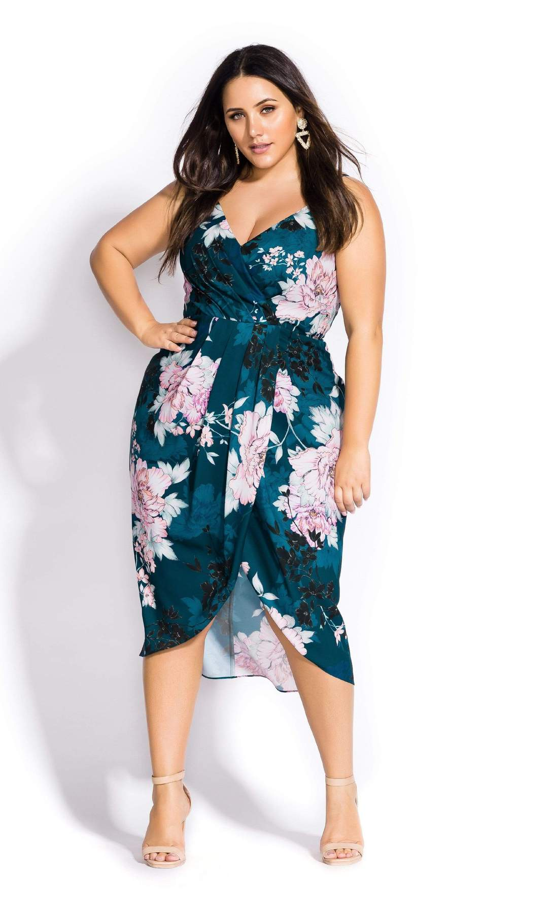 woman wearing a city chic jade bloom plus size spring dress