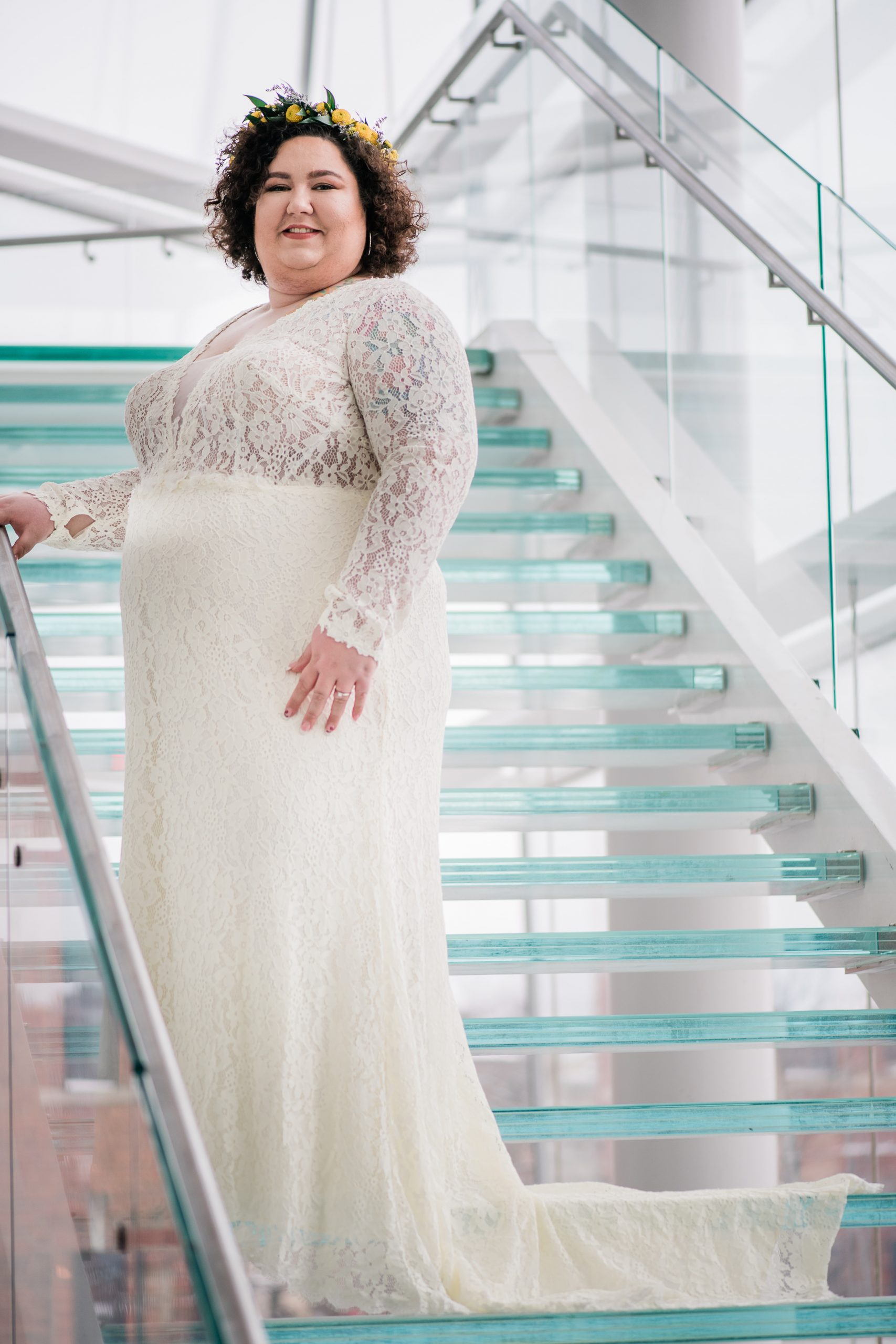 white plus size bride wearing an ivory dress