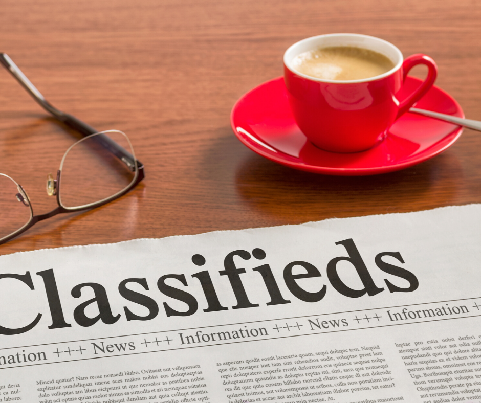newspaper open to classifieds