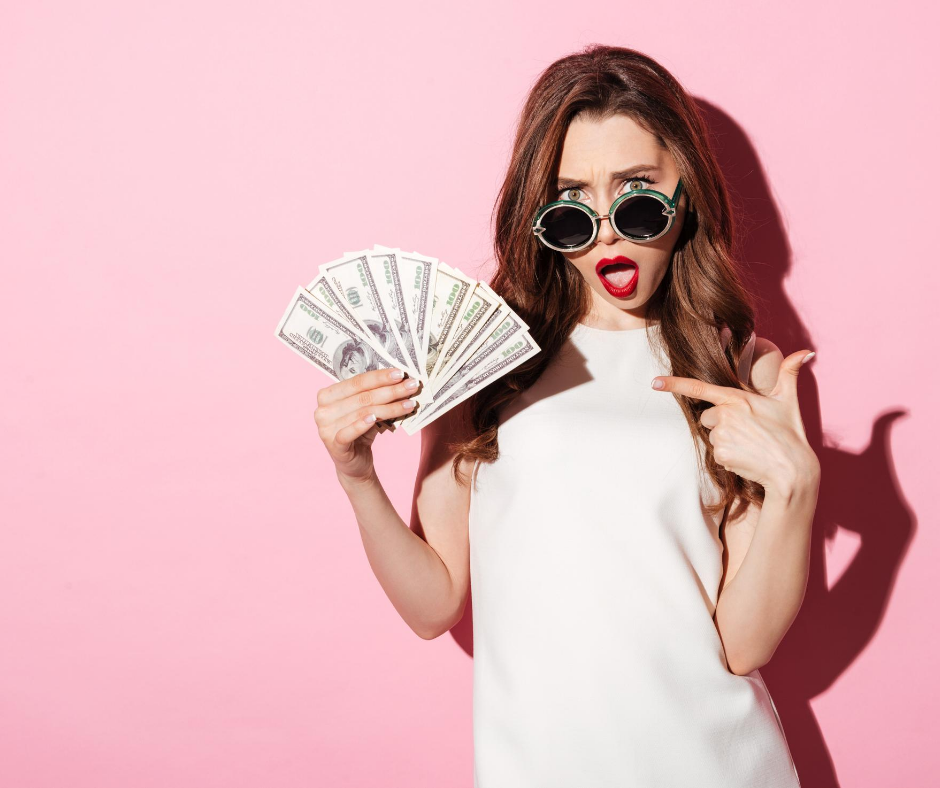 Woman holding up money