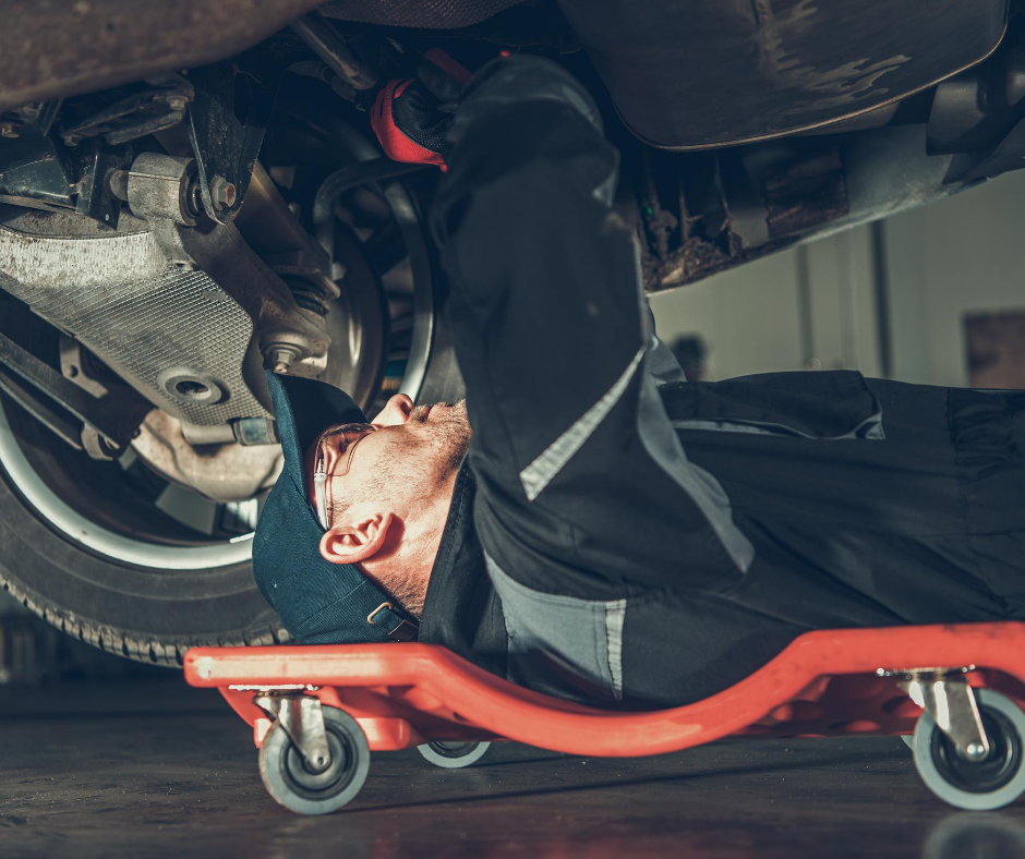 Man laying under a car fixing something