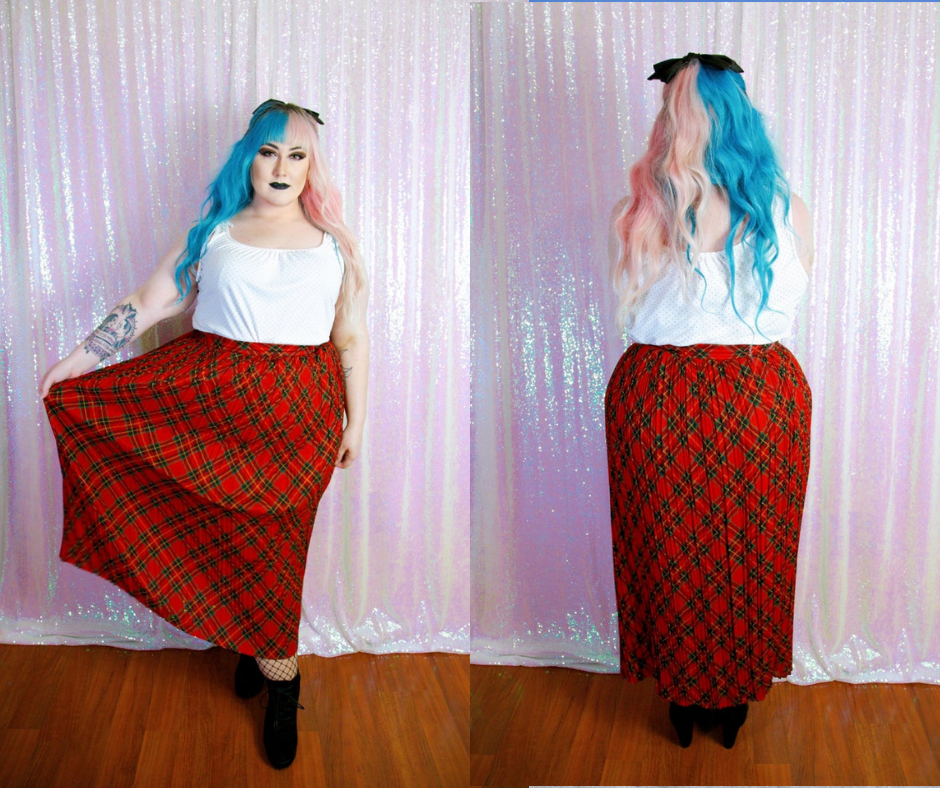 Plus size woman with blue hair wearing a plus size vintage plaid skirt